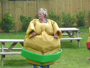 SUMO WRESTLING SUITS - ADULTS AND CHILDRENS - SUMO WRESTLING SUITS FULL PACKAGE: 4 SUITS, 4 HELMETS, 12 x 12 SUMO MAT, SUMO BOXING GLOVES